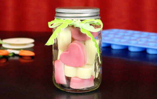 Craft these DIY solid lotion bar hearts via The Nourished Life to give to your Valentine (or Galentine!) this Valentine's Day! Made using a simple combination of natural ingredients, solid lotion bars are a wonderful and mess free way to protect and nourish your dry skin. #valentines #galentines #valentinesdaygift #skincare #diy #solidlotion