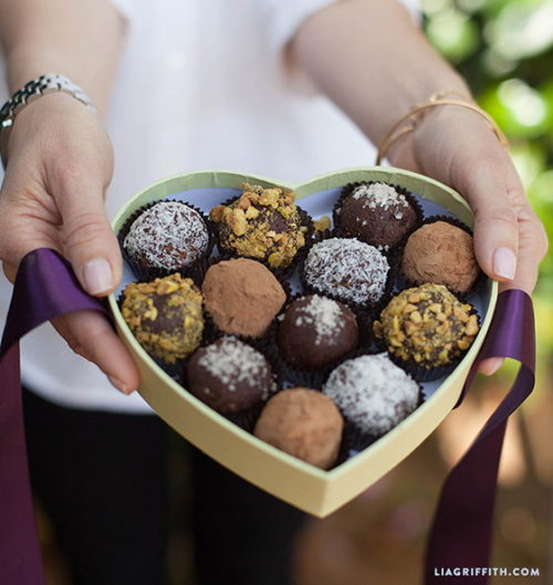 These Paleo Chocolate Bliss Bites via Lia Griffith are the perfect last minute Valentine's Day gift for the healthy foodie! Packed full of nutty goodness and sweetened with dates and agave nectar, these truffles not only hit the spot when the chocolate cravings come, they are like little nuggets of energy too!