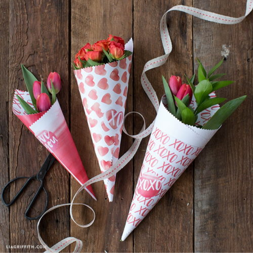 Give your Galentines the gift of flowers with these printable paper cones via Lia Griffith that are perfect for creating your own mini Galentine's Day bouquets! #valentinesday #valentinesdaygift #flowers #bouquet #printable #gifts #galentines