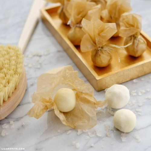 Love natural beauty recipes? Then you must try these DIY bath melts from Lia Griffith! This luxe but easy to craft homemade bath melts recipe is perfect for hydrating dry skin and is scented with natural essential oils for the perfect aromatherapeutic spa experience at home! They make great homemade gift ideas too!