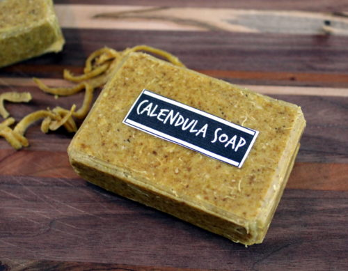 Homemade Calendula Soap! This natural calendula soap recipe is handcrafted with skin nourishing ingredients that promote skin health. Calendula hydrosol, calendula powder and chia seed oil are key ingredients for healthy looking skin. Natural shredded loofah is also included for its gentle exfoliation that leads to brighter, smoother skin.
