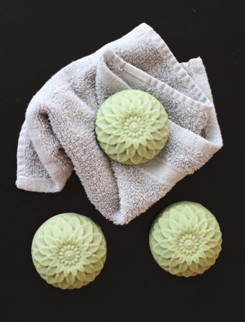 Sea Salt Shampoo Bar Recipe for natural beauty. Finding the right no poo shampoo option can be a challenge. While shampoos free of both sulfates and surfactants are becoming more common, they can be expensive to buy on a regular basis. So why not make your own natural hair care recipes? This sea salt shampoo bar recipe is made with coconut oil, sea salt and real milk & egg as ingredients for a healthy, natural hair care alternative to commercial products. Another one of my waste free homemade beauty recipes, this shampoo bar is formulated to not only moisturize and condition hair, but also to strengthen hair and promote shine.