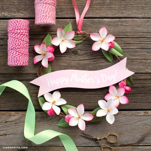 Best DIY Mother's Day Gifts That Mom Will Love! This cute mini DIY Mother's Day wreath from Lia Griffith is a great way to brighten Mom's mood on her special day. Adorned with mini paper apple blossoms,  his sweet floral paper wreath is the perfect way to surprise Mom in the morning or after work - simply hang it in a place she'll spot it easily.