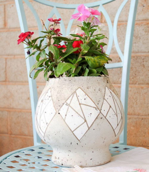 Spring Flower Craft Projects! This DIY cement flower pot from Hawthorne and Main is handcrafted using a fishbowl, glass cylinder jar and Quikrete cement. Paint your own geometric design around the pot to match your existing home decor. Then fill the planter with your favorite flowers for a beautiful way to display fresh flowers inside or outside your home.