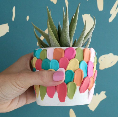 Best Mother's Day Gifts to Make Right Now! This DIY clay petal planter from A Beautiful Mess is definitely another one of the best DIY Mother's Day gifts you can craft for Mom! Inspired by a petal cake, this clay petal planter is made using a rainbow of polymer clay colors and a concrete or ceramic planter.