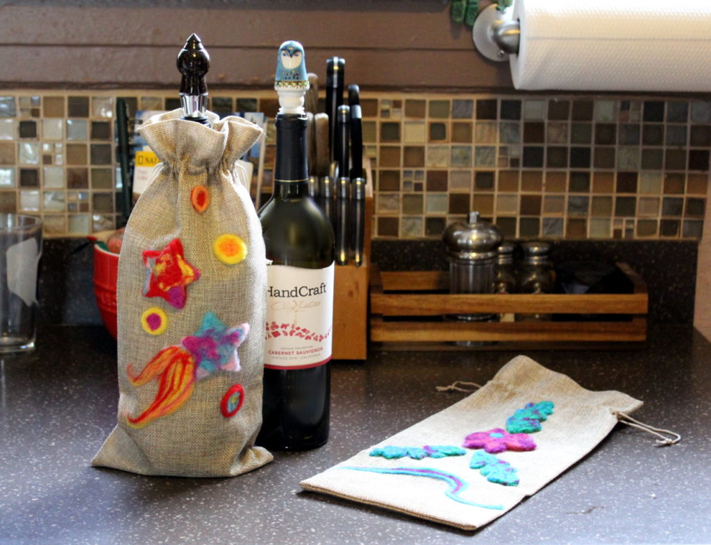DIY Needle Felted Wine Bag for Mother's Day! You don't have to take a course in needle felting for beginners to create your own needle felted projects. It's actually a lot easier to get started than you might think. Keep reading to learn how you can started in needle felting with this easy DIY needle felted wine bag that's perfect for Mother's Day!