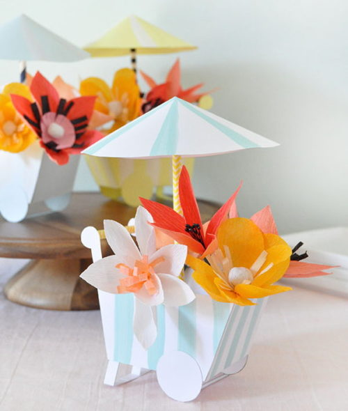 Spring Flower Craft Projects! These DIY paper flower carts from Oh Happy Day are perfect for spring entertaining. Tuck a tiny treat inside and easily turn this paper craft project into cute party favors that will delight your friends.