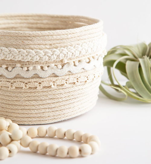 Best DIY Mother's Day Gifts! Made from clothesline rope from the hardware store, this pretty DIY rope planter is the perfect craft project for those of you who love weilding a glue gun! Then simply add a plant or some of your mom's favorite things to the basket for gifting. Learn to make it now at Alice and Lois.