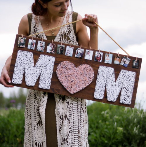 Best DIY Mother's Day Gifts! This DIY string art gift for Mother's Day from Lily Ardor is another lovely way to show off your memories! Easily personalize this string art sign with your favorite photos for a unique photo display that Mom will cherish for years to come.