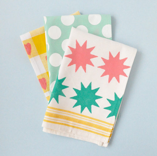 These easy DIY stenciled tea towels from Handmade Charlotte are sure to become one of Mom's favorite kitchen accessories and definitely one of her best DIY Mother's Day gifts! Handmade using plain tea towels, stencils and fabric paint, everyone in the family can join in on crafting this delightful surprise for Mom this Mother's Day!