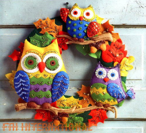 Accessorize your home this fall with some color! This DIY owl wreath kit comes with everything you need to create and embroider your own fall wreath. This wreath features three colorful owls perched on oak tree branches among the acorns and leaves that have turned from their summer green to the familiar orange, tan and yellow of the fall season.