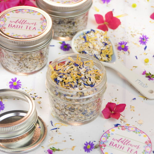 Natural wildflower bath tea recipe for natural skin care. This natural wildflower bath tea recipe from guest blogger Irena of Country Hill Cottage is perfect for year round self care! Crafted using natural herbs and essential oils, this fragrant bath tea makes lovely addition for a spa day at home. Or gift the finished product as relaxing homemade gift for someone special.
