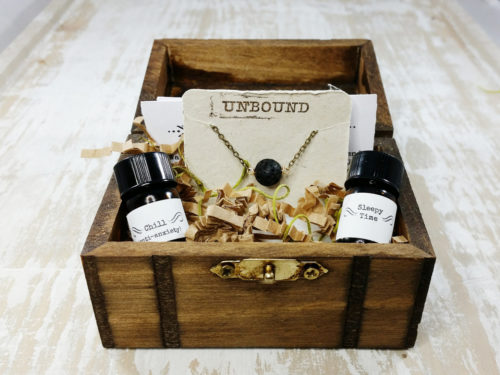 Essential oil gift box for unique holiday gifts. This adorable wooden gift box from Unbound Elements includes a set of two essential oil blends of your choice, one diffuser necklace, description cards and two aromatherapy inhalers.