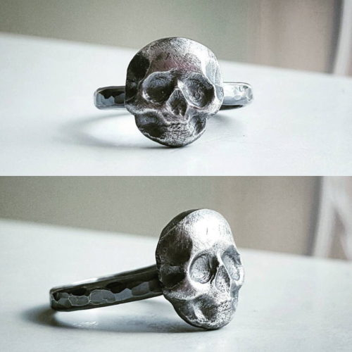 Handmade sterling silver skull ring from Magpie Metalworks. A unique Christmas stocking stuffer idea for him. This is one of the coolest rings! I use a shot plate made by another maker to form the skull and solder it to a half round hammered band. I then add a rich patina to the ring before polishing to give it a darker look and feel. It's chunky, rustic, and awesome!