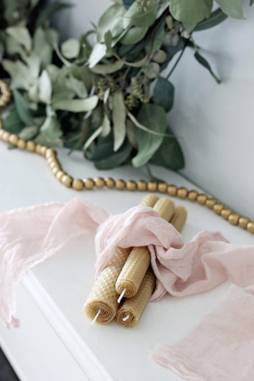 Best homemade winter gifts for Christmas. These simple, natural beeswax candles from Hello Nest only take five minutes to create. Perfect for any minimalist in your life, this gift also makes a lovely addition to anyone's home decor. Even better, you can buy beeswax sheets with Prime shipping for the perfect last minute holiday gift idea.