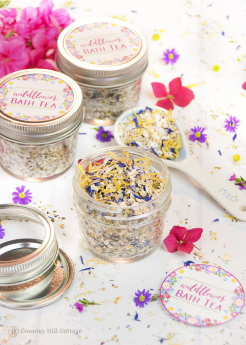 Wildflower Bath Tea Recipe for your self care beauty regimen. This natural herbal skin care recipe is perfect for self care any time of the year. A guest post from Irena of Country Hill Cottage, this indulgent herbal bath tea is made using a combination of herbs & botanicals, natural essential oils and skin soothing oatmeal & Dead Sea salt. This fragrant wildflower bath tea is a great way to relax and care for your skin. Plus it's perfect for homemade gifts with Valentine's Day right around the corner!