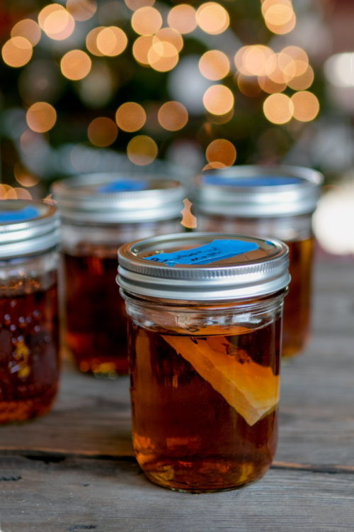 DIY Christmas gifts for men. Gifts for guys can be hard. However, this DIY for wood infused liquor from Man Made DIY is perfect for homemade winter gifts for him. Simply infuse a piece of grilling wood - along with dried fruits and spices if desired - to create unique holiday alcohol blends that can be enjoyed throughout the winter holiday season.