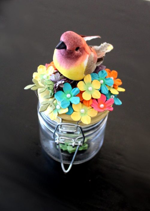 This mini decorative DIY spring mason jar is so simple to make. In 10-minutes or less you can create a decorative mini mason jar that's perfect for decorating your small spaces. You can also use these cute little mason jars for storage to stash trinkets like jewelry and rings. Or use them as pretty gift wrapping for your homemade bath salts or Easter treats this spring. While I used mini hinged jars for this DIY home decor project, you can recreate this DIY you can easily use mason jars of any size.