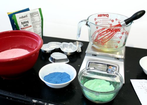 Ingredients and bath bomb colorants for mixing and making hidden color bath bombs.