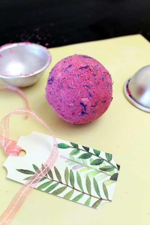 Rose bath bomb DIY for homemade Mother's day gifts. Made using a fragrant rose essential oil blend, this essential oil bath bomb recipe makes a lovely DIY gift. Whether you're looking for handmade spring inspired gifts for Mother's day or a treat for a summer birthday, this easy bath bomb recipe will delight your recipient. And, give them an excuse to take time out for self care.
