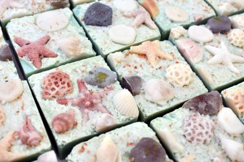 Handmade artisan island dreams soap with sea salt. Crafted by Spruce Mountain Soap, this handcrafted soaps are the perfect addition to your summer beauty routine. Because really, who doesn't dream of soaking in the sun on a warm, soothing beach?
