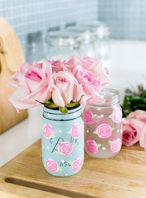 Hand Painted Rose Mason Jars for the best Mother's Day gifts to DIY. You can't beat these lovely hand painted rose mason jars as another of the best Mother's Day gifts & ideas to DIY. Not only are these mason jars beautiful, they also have a number of uses. Mom will love using these decorative jars as vases or to store kitchen staples! Discover the tutorial for making hand painted roses at It All Started with Paint.