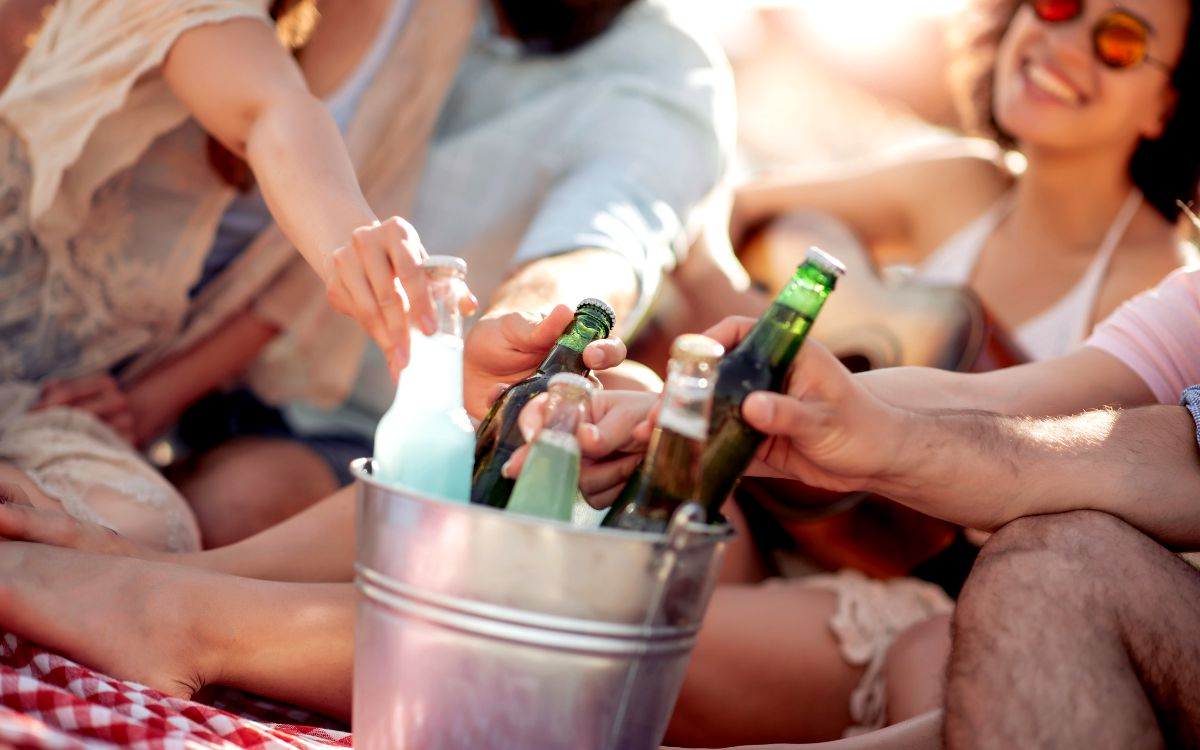 Outdoor summer party with on the go drinks in a cooler.
