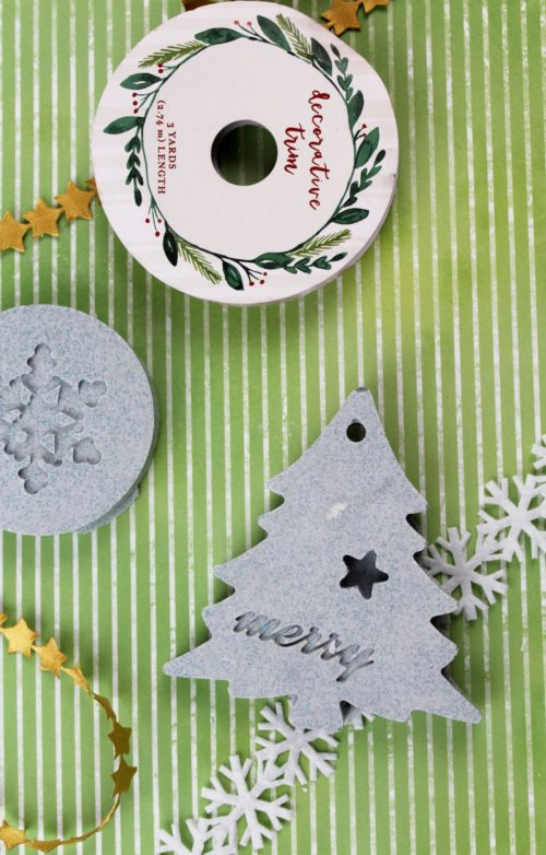 Plaster essential oil ornaments for your Christmas tree colored with natural indigo powder to give the look of concrete. Pair these easy handmade Christmas ornaments with a bottle of a holiday essential oil blend for DIY holiday gifts for friends, family & coworkers this holiday season.
