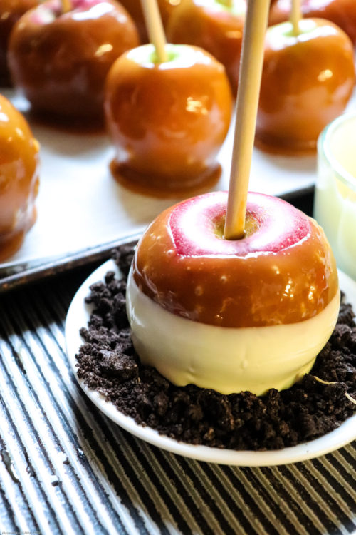 White chocolate dipped gourmet caramel apples with crushed Oreo cookies topping.