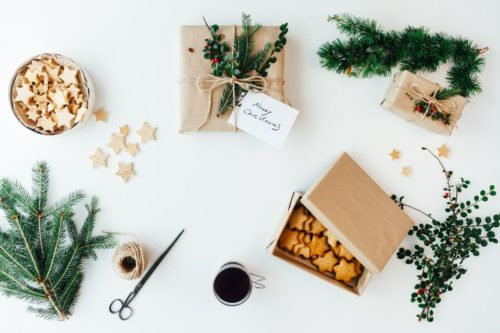 Eco friendly natural gift wrapping ideas for Christmas with dried botanicals, oranges and forage evergreen leaves.