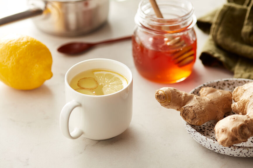 Natural Cold Remedy Tea for natural cold and flu relief. Support your immune system with this homemade cold and flu drink. Ginger, honey, lemon and optional whiskey combine for an easy homemade tea for cold and flu that will help you feel better quickly and help shorten the duration of a cold or the flu. Life doesn't stop when you wake up with a sore throat or a stuffy nose. At the first sign of a cold, I make this homemade cold remedy drink to give my immune system natural support.