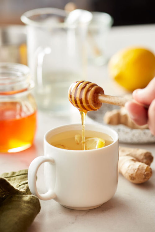 Natural Cold Remedy Tea for natural cold and flu relief. Support your immune system and soothe symptoms with this natural cold remedy tea. Ginger, honey, lemon and optional whiskey combine for an easy homemade tea for cold and flu that will help you feel better quickly and help shorten the duration of a cold or the flu. Life doesn't stop when you wake up with a sore throat or a stuffy nose. At the first sign of a cold, I make this homemade cold and flu drink to give my immune system natural support.