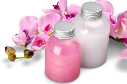 Shampoo and conditioner bottles with pink orchids