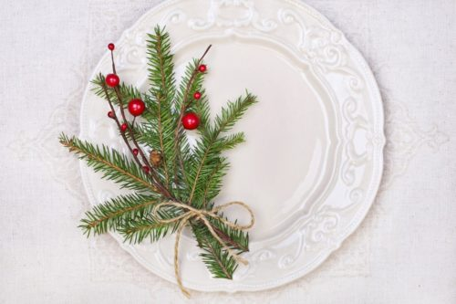 Decorative plate with evergreen sprigs and berries for home decor