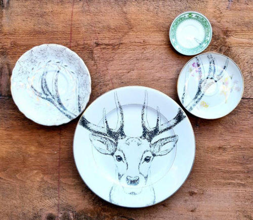 Upcycling ideas for mismatched plates or vintage plates with decorative lead paint. This wall art idea from Sabotage900 on Etsy features an illustrated deer for fun & quirky, unique home decor using repurposed dishes.