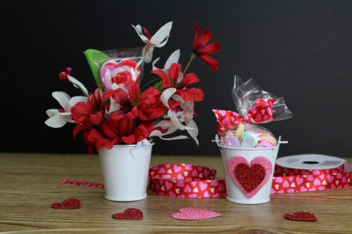 Dollar Tree valentines. Easy DIY Dollar Tree valentines two ways in 5-minutes or less. Dollar Store crafts for Valentine's day to give as candy filled Valentine's Day gifts. Whether you need valentines or gift ideas for someone special or a Valentine's day party, these easy DIY Dollar Tree valentines are the perfect way to show you care without spending a lot of money. Crafted entirely using products from the Dollar Store, these valentines are easy to create and customize. #valentines #diy
