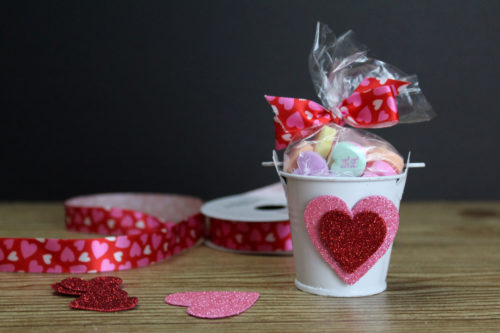Dollar Tree valentines with candy hearts. Whether you need valentines or gift ideas for someone special or a Valentine's day party, these easy DIY Dollar Tree valentines are the perfect way to show you care without spending a lot of money. Crafted entirely using products from the Dollar Store, these valentines are easy to create and customize. Learn how to craft your own Dollar Tree valentines two ways. Conversation hearts are a Valentine's day classic. #valentines #dollarstorecrafts