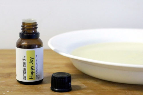 Adding an essential oil blend to melted liquid melt and pour soap base