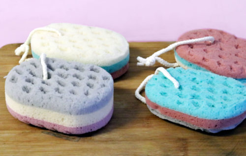 Bath sponges with ropes for hanging to dry