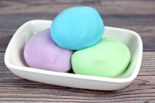 Play Dough Soap DIY: A Kids Activity for Bath Time Fun. Make hand washing and bath time fun with this soap play dough recipe with liquid castile soap. This DIY play doh soap is easy to make, and older kids can even make it themselves. You can even scent these with a kid safe blend of natural essential oils for aromatherapeutic bath time fun! A creative, kid-approved project to try when you're stuck indoors, this project is perfect for those who homeschool or have bored children at home.