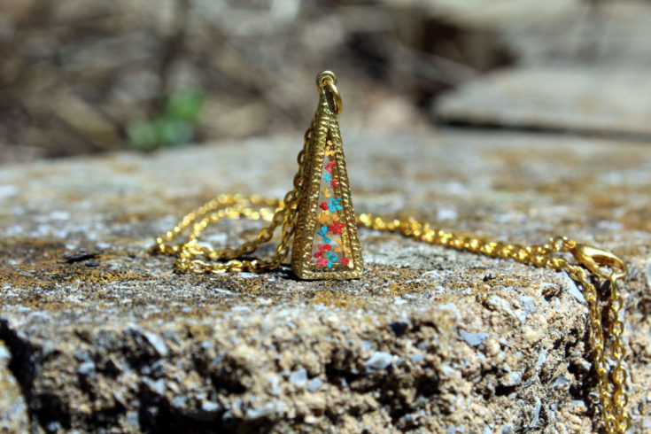 Pyramid resin botanical necklace. Unique fashion jewelry made with real dried flowers preserved in resin to compliment your everyday wardrobe. Wear it to dress up jeans and a cute top, or use it to accent that fun flirty dress. It's easy to update your existing wardrobe on a budget with customizable botanical resin jewelry from Ann and Joy. These affordable fashion jewelry accessories allow you to save money and take the challenge out of shopping for new fashions by updating your old outfits.