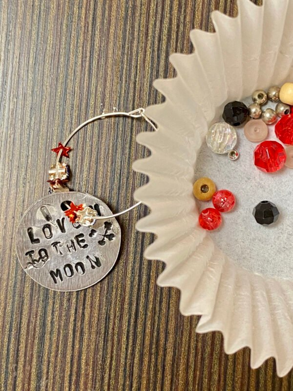 DIY Wine Glass Charms: Women's Craft Night Ideas for Make & Take Crafts. Looking for a fun make and take craft project for your women's craft night? These DIY wine glass charm ideas are a fun adult craft for every skill level! An easy and fun adult craft night idea for women of all skill levels, this project is perfect for a wine and art night with friends. Pair your event with your favorite bottle of wine and a good time is guaranteed! Learn how to use metal stamping to make wine glass charms.