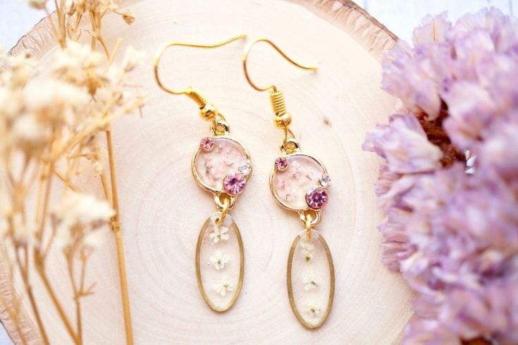 Resin botanical drop earrings. A unique jewelry fashion accessory for spring made with real dried flowers preserved in resin. Update your existing warm weather wardrobe on a budget with customizable botanical resin jewelry. These affordable fashion jewelry accessories are made with real flowers preserved in resin. Save money and take the challenge out of shopping for new spring and summer fashions by updating your old outfits with fresh jewelry accessories that stand up to the test of time.