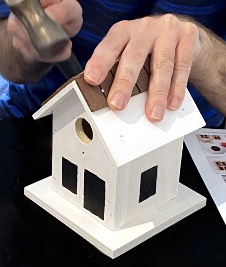 Nailing shingles onto a birdhouse roof from the top instead of the bottom, an easy mistake