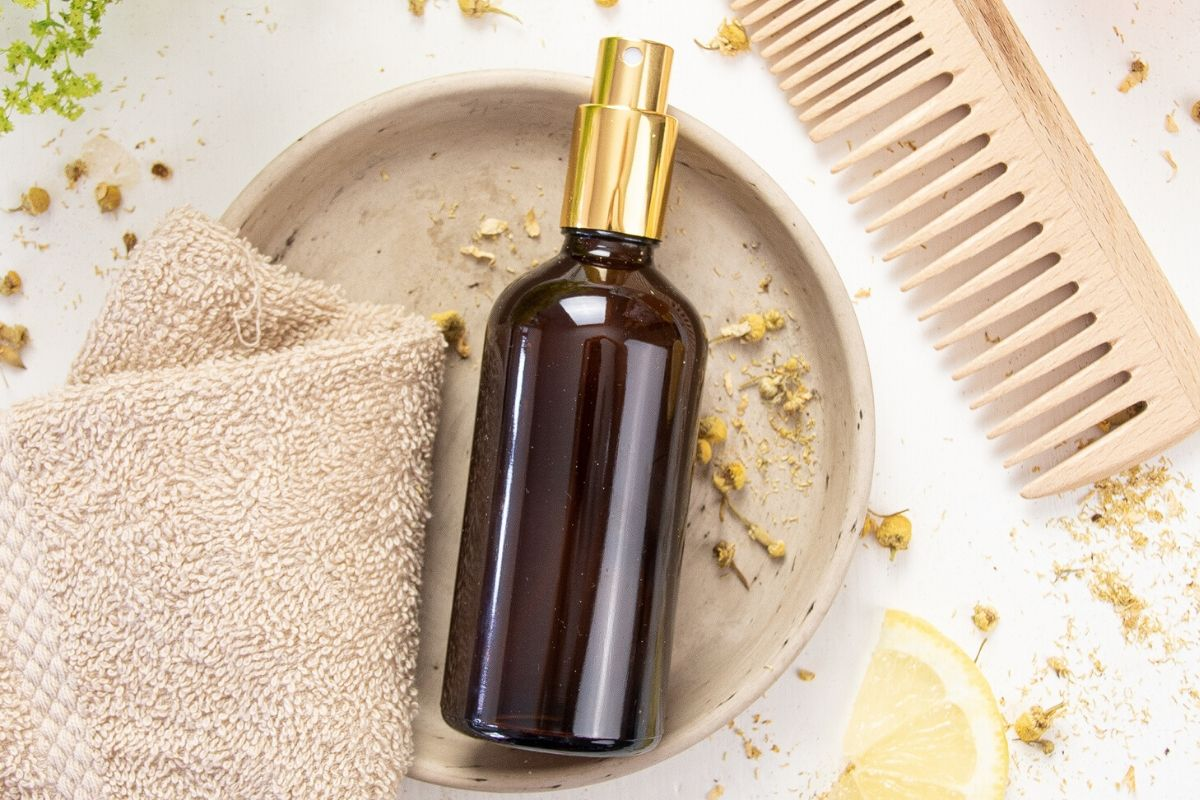 Lighten hair naturally with an easy, herbal DIY hair lightener spray. This homemade hair lightener sets soft highlights & lends a healthy, sun-kissed glow. Want to learn how to lighten hair naturally? Discover different ways for to naturally lighten your hair with everyday ingredients, such as honey, chamomile, lemon juice, and salt. You will also learn how to create a DIY hair lightener spray, that sets soft highlights and gives your mane a healthy, sun-kissed glow.