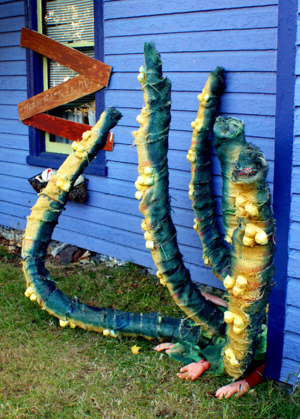 Upcycled Halloween decorations. This DIY outdoor upcycled Halloween decor was crafted by a friend of mine using upcycled materials. She used Dollar Tree pool noodles to create creepy Halloween decorations. To create this upcycled Halloween decor, she first taped three pool noodles together. She then zip tied the egg cartons onto the pool noodles to form the suckers. Finally, burlap was wrapped around the pool noodles and then spray painted in a variety of colors to give the tentacles life.