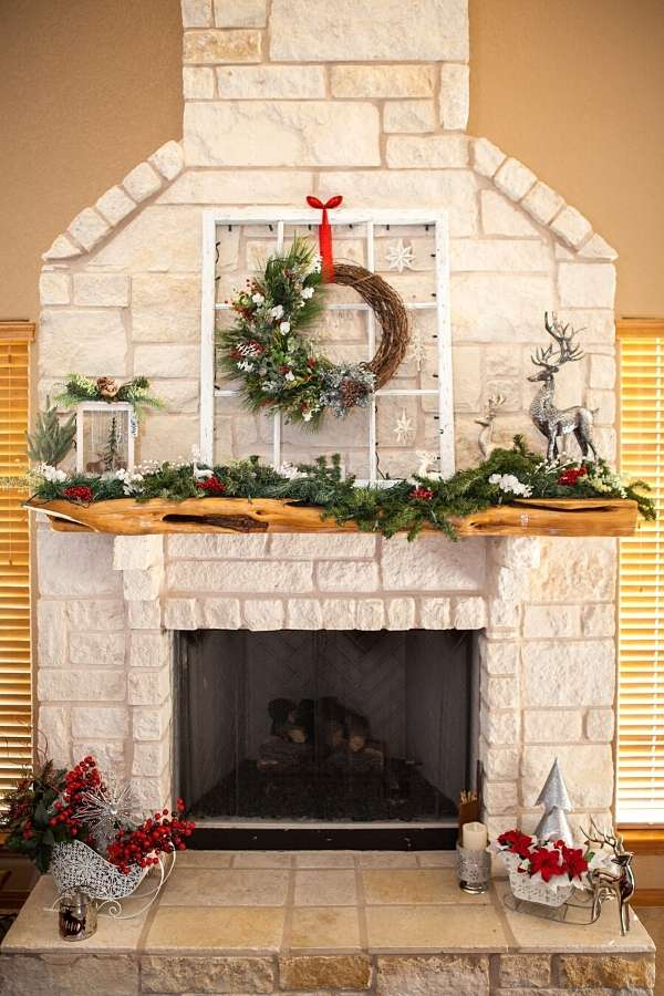Winter home decor ideas. Learn how to make DIY winter lanterns for winter home decor after Christmas with this winter wonderland craft project. This winter lantern decor looks beautiful displayed on fireplace mantel along with my DIY winter wreath. For a smaller display, you make this winter terrarium the centerpiece for your mantel and surround it with faux snow and pinecones, along with the greenery of your choice as a winter home decor idea. Or set your lantern on a side table or bookshelf.